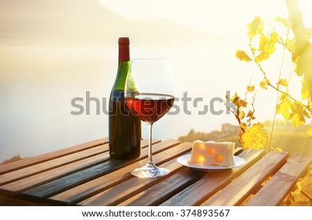 Wine and cheese against Geneva lake, Switzerland - stock photo
