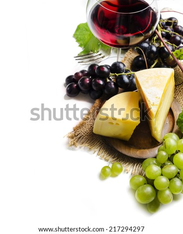 Wine and cheese on white background - stock photo