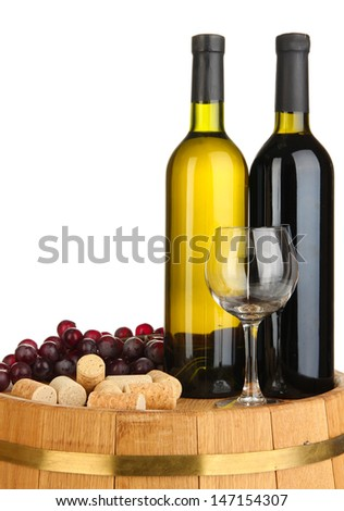 Wine and corks on barrel isolated on white - stock photo