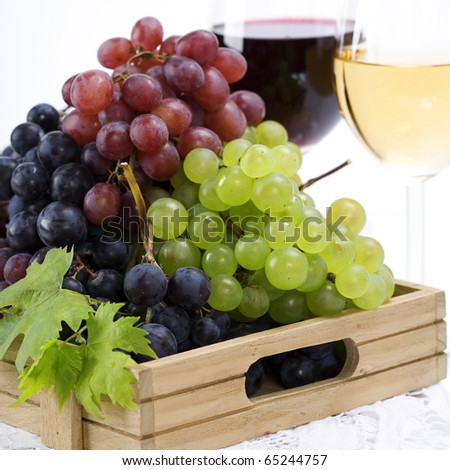 wine and grape composition over white - stock photo