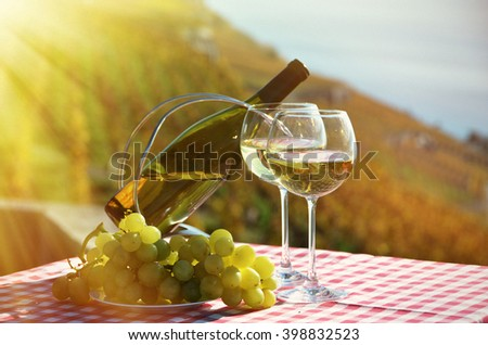 Wine and grapes against vineyards in Lavaux, Switzerland - stock photo