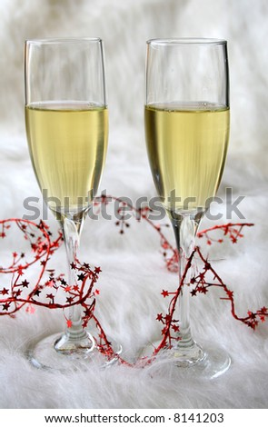 Wine and red foil string on a dramatic looking background. - stock photo
