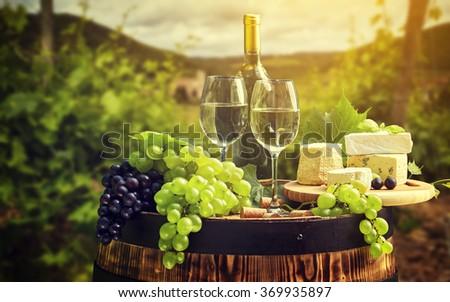 Wine and vineyard in Tuscany sunset. Italy - stock photo