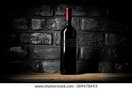 Wine and wall of bricks - stock photo