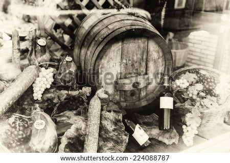 Wine barrel and dried meat assortment in vintage setting - stock photo