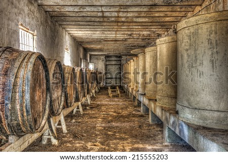Wine barrels and vats in an abandoned wine cellar, HDR - stock photo