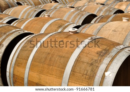 Wine Barrels being stored - stock photo