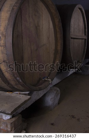 Wine barrels in wine-vaults in order - stock photo
