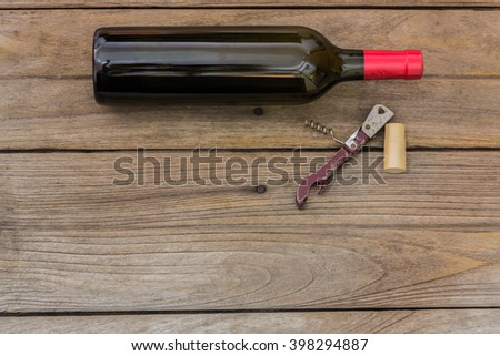 wine bottle and corkscrew - stock photo