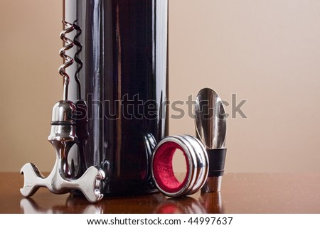Wine bottle and elegant wine set - stock photo