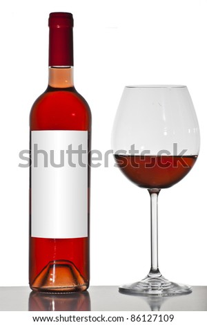 Wine bottle and glass - stock photo