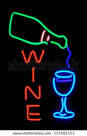 Wine bottle and glass modern fluorescent neon store sign at a wine store - stock photo