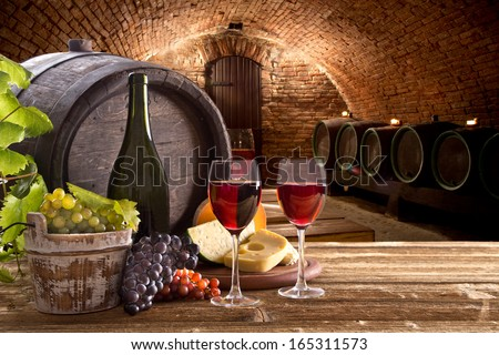 Wine bottle and glasses with wodden barrel - stock photo