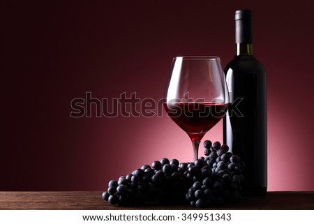 Wine bottle and red wine - stock photo