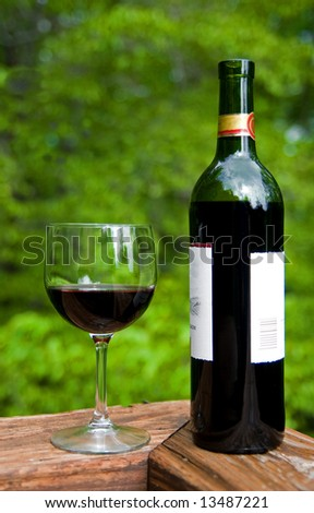 Wine Bottle and Wine Glass - stock photo