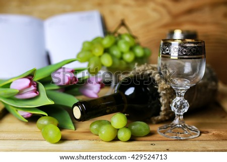 wine bottle book and glass grape  - stock photo