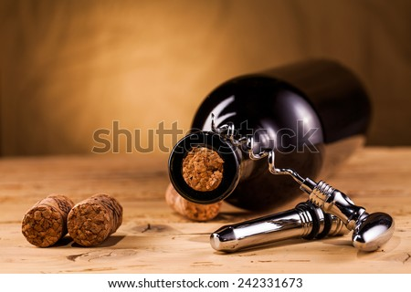 wine bottle corks and corkscrew on table - stock photo