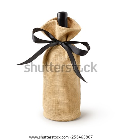 Wine bottle gift sack bag with ribbon bow isolated on white background. - stock photo