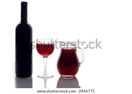 Wine bottle,glass of red wine and wine pitcher isolated on white - stock photo