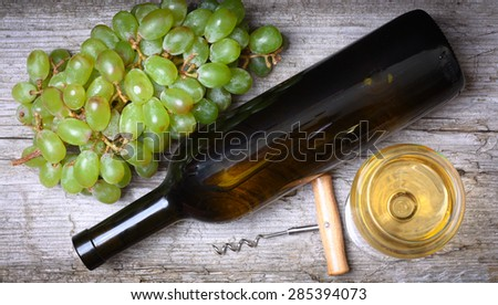 wine bottle, grapes and a glass of wine - stock photo