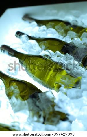 wine bottle in ice - stock photo