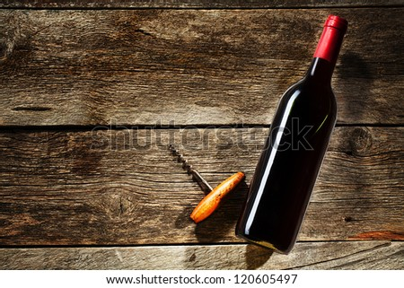Wine Bottle on a wooden background - stock photo
