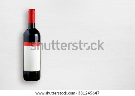 Wine bottle on white table top view - stock photo