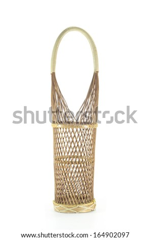 Wine bottle rattan basket isolated. - stock photo
