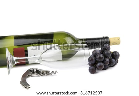 Wine bottle wine glass, a corkscrew and dark grapes on a white background. - stock photo