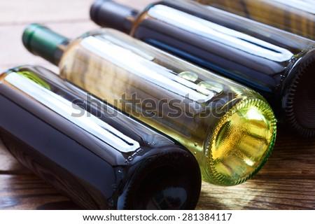 Wine bottles close up on wooden desk. Flat mock up for design. - stock photo