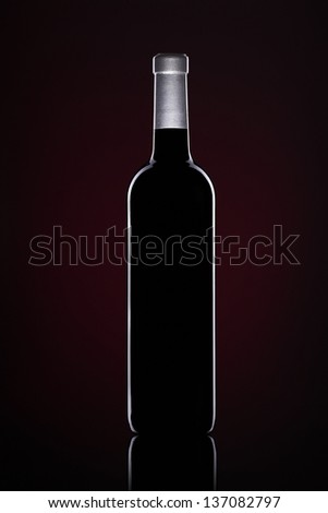 Wine bottles on Black background with red - stock photo
