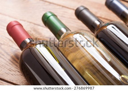 Wine bottles on wooden background - stock photo