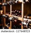 Wine cellar full of wine bottles - stock photo