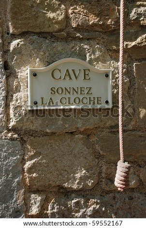 wine cellar sign and ring the bell cord - stock photo