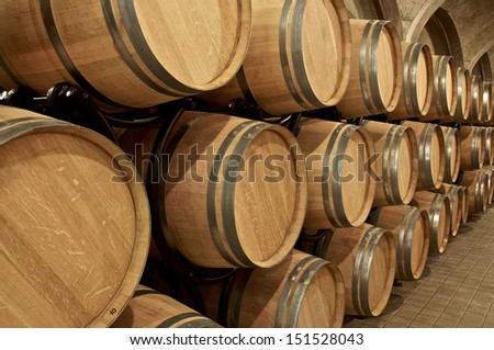 Wine cellar with in barrels - stock photo