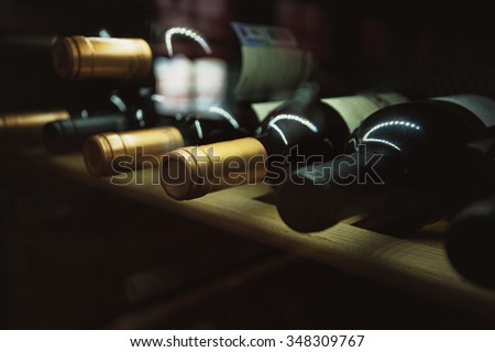 Wine cellar with old riesling wine - stock photo