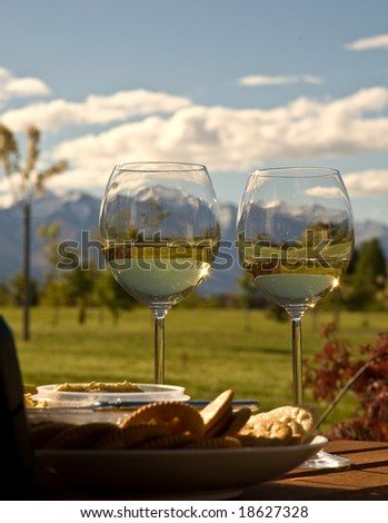 Wine, cheese and crackers ready for relaxing afternoon in Wanaka, New Zealand - stock photo