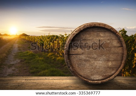 Wine composition with background of vineyard - stock photo