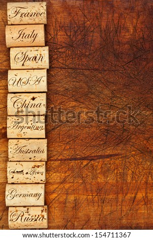 Wine cork border with the top ten Wine countries of the world on wooden background - stock photo