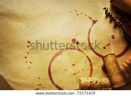 Wine Cork, Corkscrew and red wine stains on the vintage paper background - stock photo