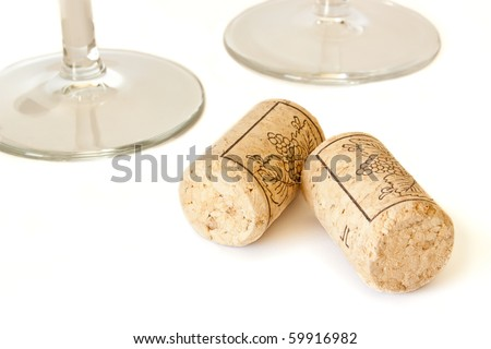 Wine cork isolated on white background and two wine glasses - stock photo