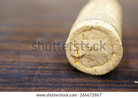 Wine cork on wooden background - stock photo