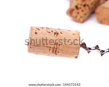 Wine corks and cokcrew on a white background - stock photo