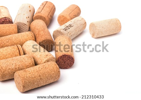 Wine corks and corkscrew isolated on white background - stock photo