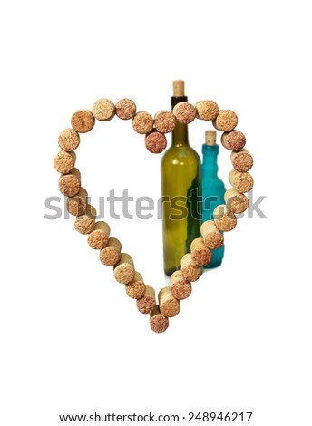 wine corks in the form of heart on the background of wine bottles  - stock photo
