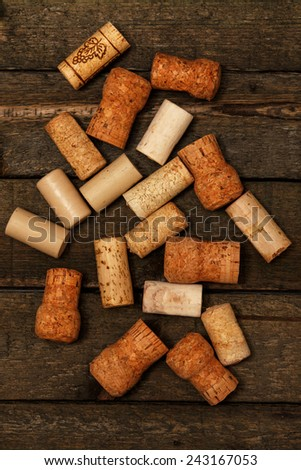 Wine corks on wooden table - stock photo