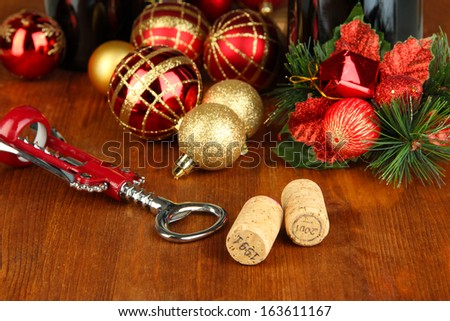Wine corks with new Year toys on wooden table close-up - stock photo