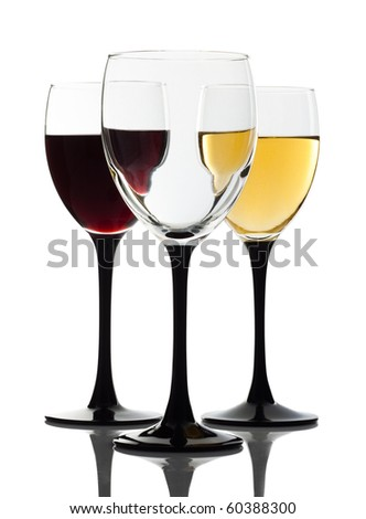 Wine glass and two glasses on a background - stock photo