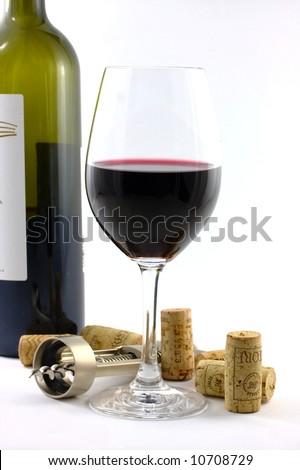 wine glass, bottle and opener - stock photo