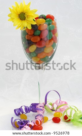 Wine glass filled with jelly beans - stock photo
